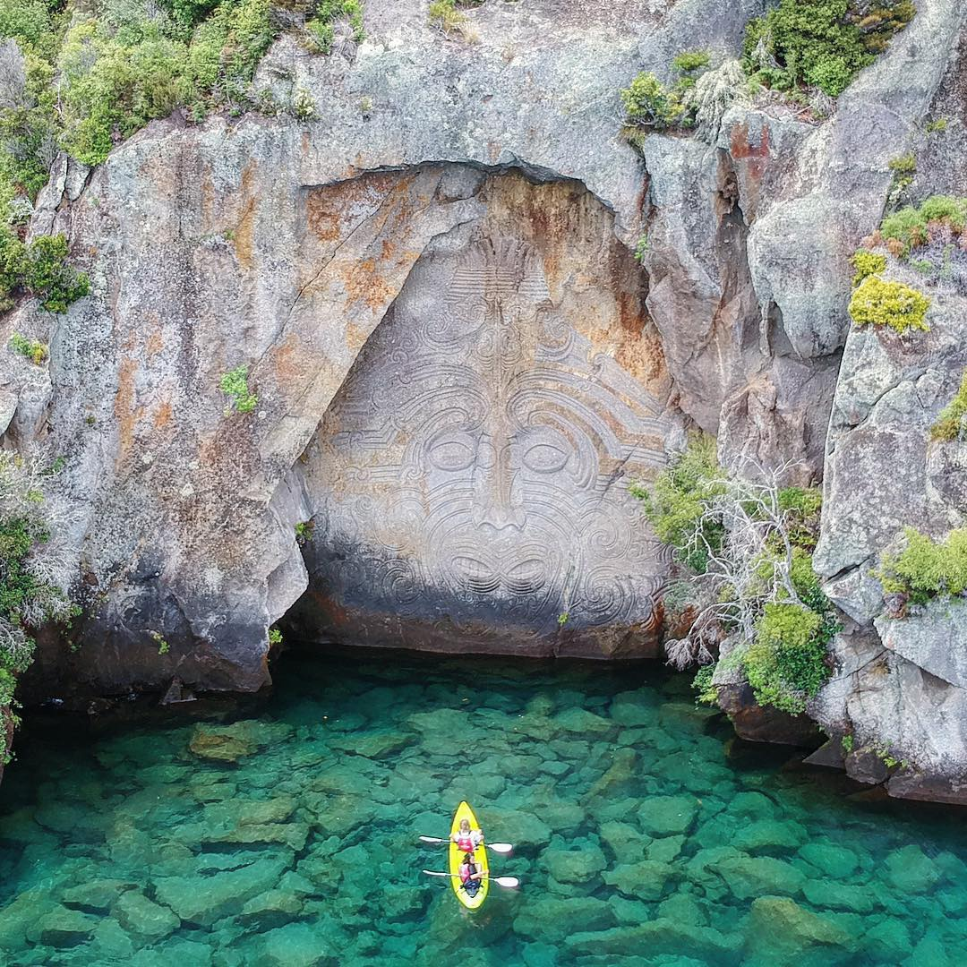 photo of cliff face with maori carvings on lake Taupo