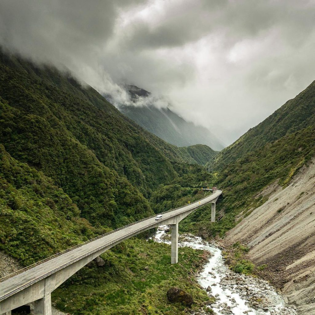 cloudy mountains with bridge road